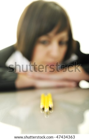 young business woman choosing right yellow pencil and representing concept of perfection and order - stock photo