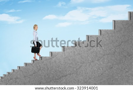 Young business woman climb stairs to sky - stock photo