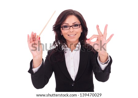 young business woman conducts with a baguette and a smile . on white background