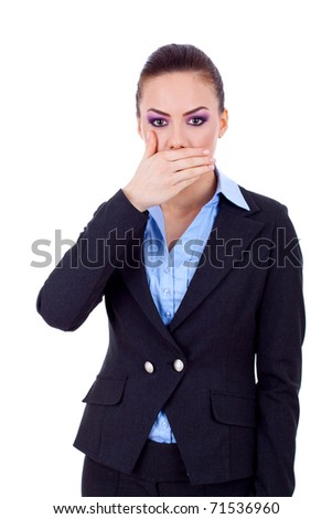 Young business woman covering her mouth with hand - stock photo