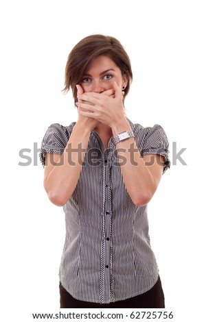 Young business woman covering her mouth with hands - stock photo