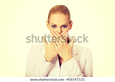 Young business woman covering her mouth with two hands