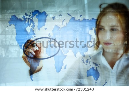 young business woman doing stock market analysis and marking the crisis area on the world map . - stock photo