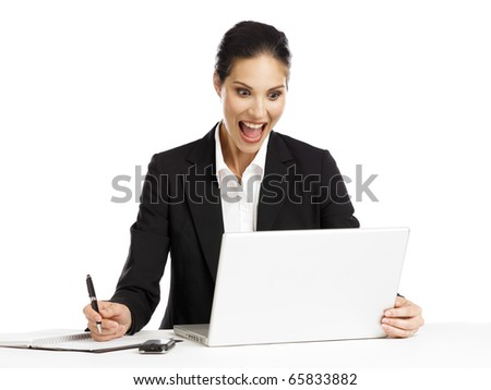 young business woman exited looking at computer - stock photo
