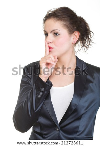 Young business woman finger on lips gesturing silence sign, isolated on white background. - stock photo
