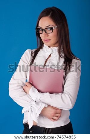 young business woman hold a folder, on blue background