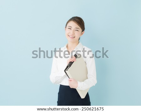 Young business woman holding a file - stock photo