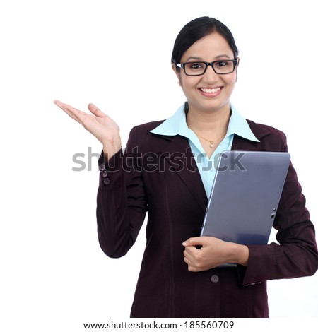 Young business woman holding a tablet computer