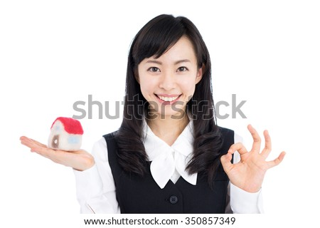 Young business woman holding a toy house, isolated on white background - stock photo