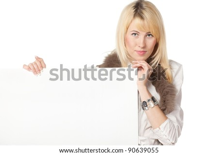 Young business woman holding a white blank billboard / placard, isolated on white background