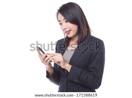 Young business woman holding and texting on  smartphone