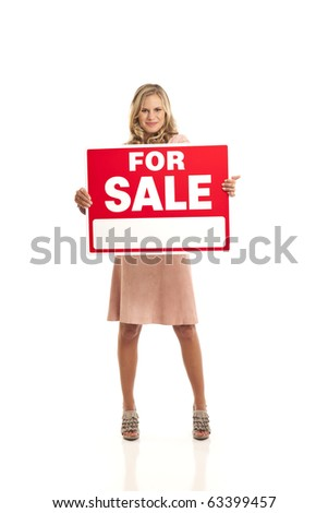 Young business woman holding for sale sign