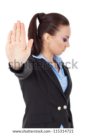 young business woman holding hand out to stop viewer. talk to the hand gesture looking away from the camera. isolated on white background - stock photo