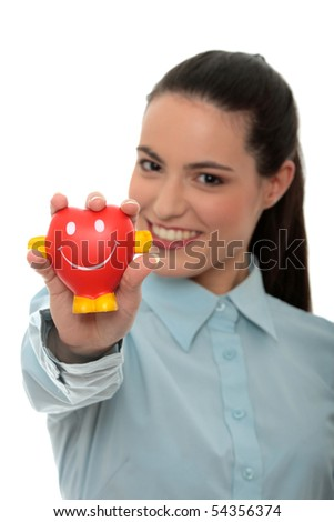 Young business woman holding heart shaped toy - stock photo