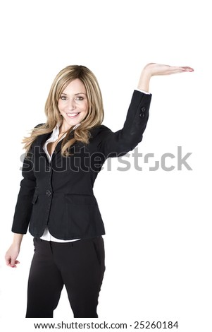 Young business woman holding her hand up supporting object - stock photo