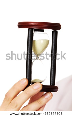 Young business woman holding hourglass.Time concept. - stock photo