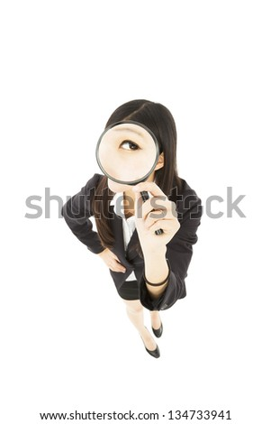 Young business Woman holding Magnifying Glass - stock photo