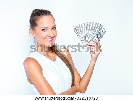 young business woman holding money. portrait of a beautiful girl holding money isolated on white background - stock photo