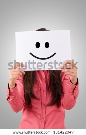 Young business woman holding paper with happy smiley on gray background. - stock photo