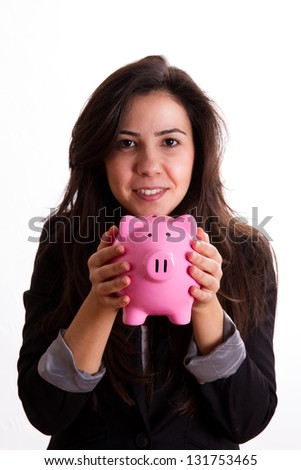 Young business woman holding pink piggy bank, one side light, isolated on white background.