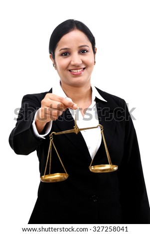 Young business woman holding the justice scale - stock photo