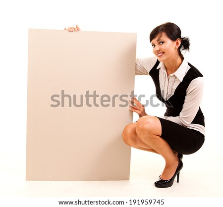 young business woman holding the poster, white background - stock photo