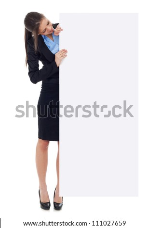 Young business woman holding white blank empty billboard sign. Isolated on white background in full length. - stock photo