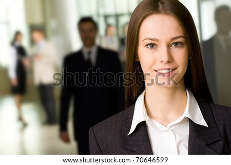 Young business woman in an office environment - stock photo