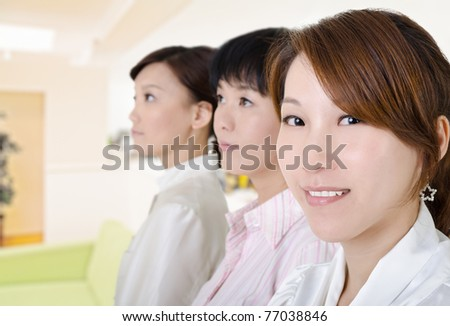Young business woman in office environment, half length closeup portrait inside of modern buildings. - stock photo