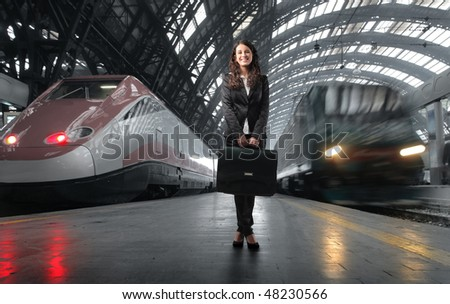 young business woman in station - stock photo