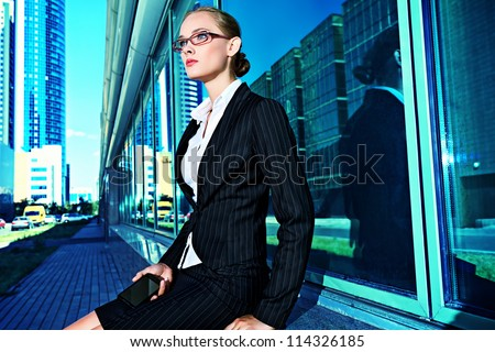 Young business woman in the big city purposefully looking away. - stock photo