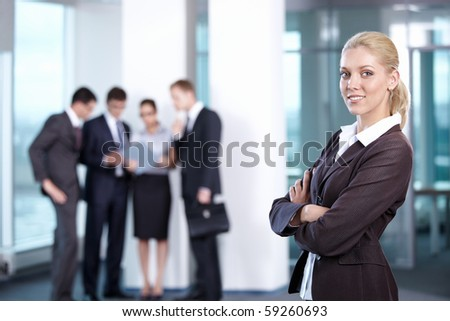 Young business woman in the foreground - stock photo