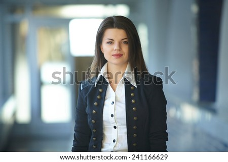 Young business woman in the hallway - stock photo