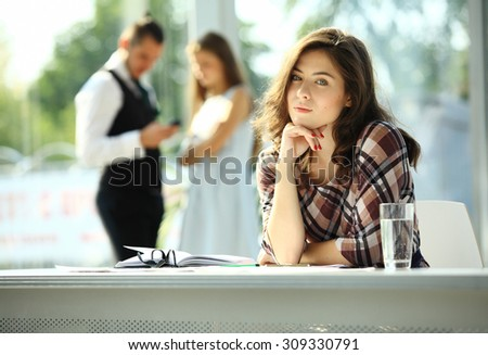 Young business woman in the office - stock photo