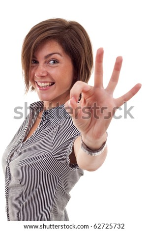 Young business woman indicating ok sign. Isolated over white background - stock photo