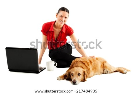 Young business woman is enjoying with dog.  - stock photo