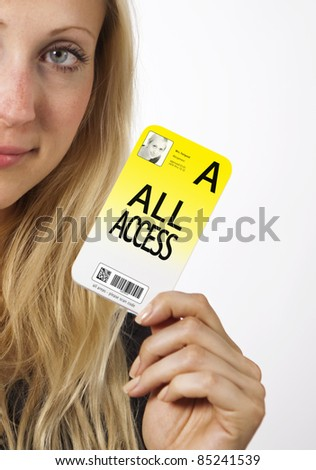 Young Business woman is smiling while showing her security pass - stock photo