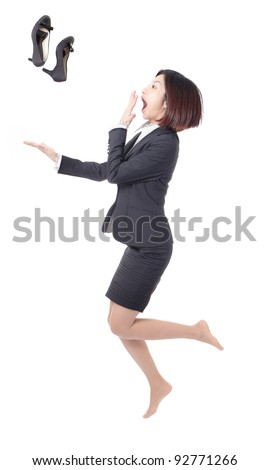 Young Business woman jump and throw high heeled shoes into air isolated on white background - stock photo