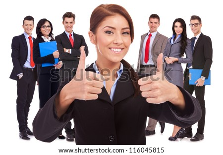 young business woman, leader of her team, making the ok thumbs up gesture - stock photo