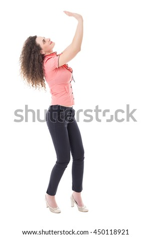 Young business woman lifting something heavy isolated over white