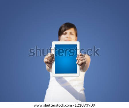 Young business woman looking at modern tablet - stock photo