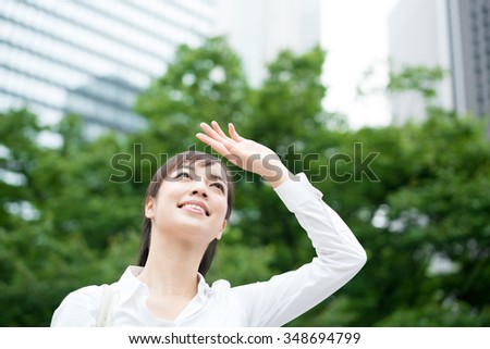 young business woman looking up - stock photo