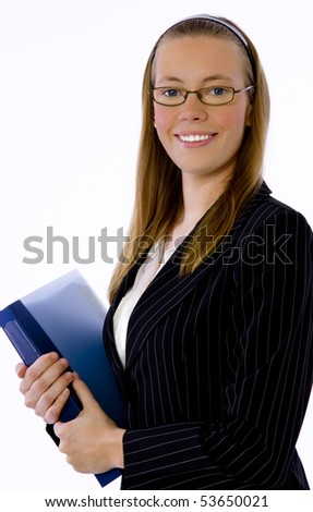 Young business woman looks confidently at camera. - stock photo