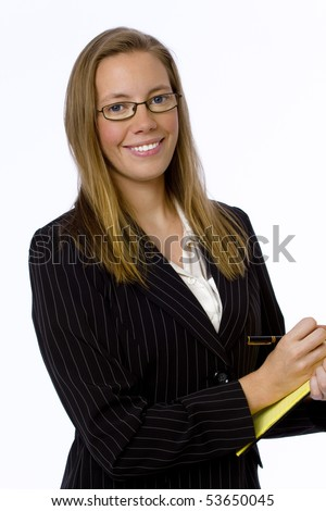 Young business woman looks confidently at camera.