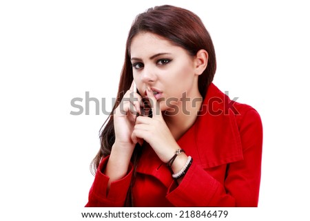 young business woman making hush gesture during phone call - stock photo