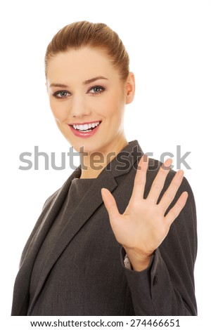 Young business woman making stop sign with her hand. - stock photo