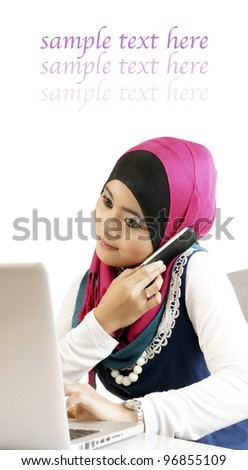 Young business woman multitasking using phones and laptop in office - stock photo