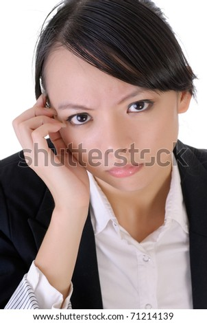 Young business woman of Asian with worried expression on face. - stock photo