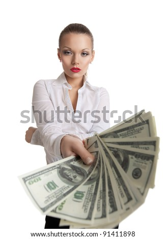 young business woman offer a bundle of money - stock photo