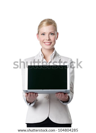 Young business woman offers computer product, isolated on white background - stock photo